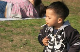 Shanghai's smoking baby insists on cigarettes not candy thanks.