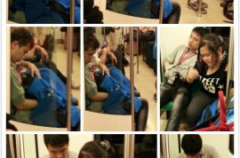 Oh really? Tapei subway rider receives head whilst pretending to read newspaper.
