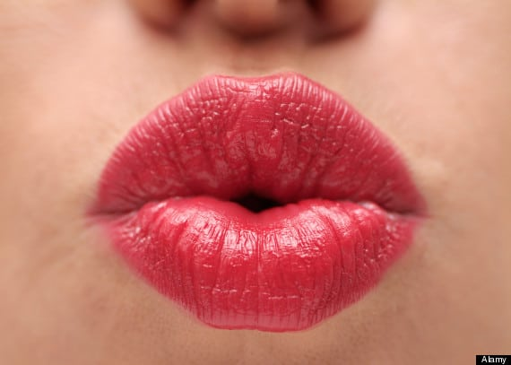 Lips of a Female Wearing Bright Red Lipstick Close Up