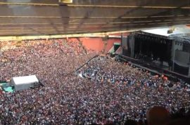 Listen to a packed stadium singing Bohemian Rhapsody whilst waiting for Green Day.