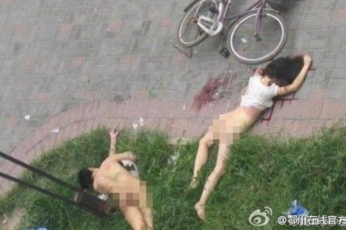 Chinese couple having sex by window