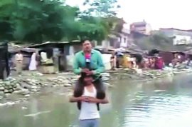 Indian TV reporter fired after reporting news sitting on flood victim's shoulder.