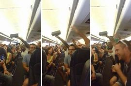 Passengers sing 'I believe I can fly' whilst stranded on tarmac for 3 hours.