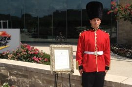 Here is an intern for Pizza Hut dressed as a royal guard in 95 degrees.