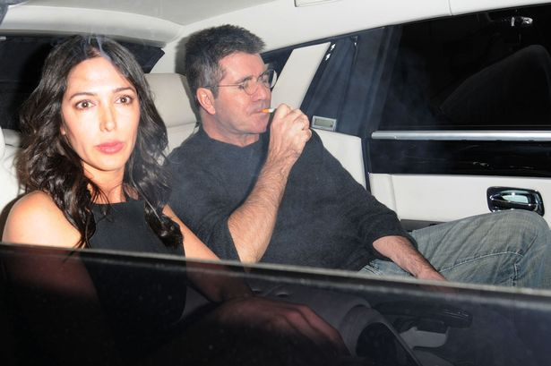 Lauren Silverman and Simon Cowell.