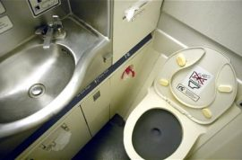 How one Qantas flight became a poop disaster. Toilets jammed as passengers became sick.