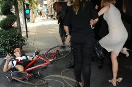 Nicole Kidman gets run over by a paparazzi on a bike and is now pissed off.