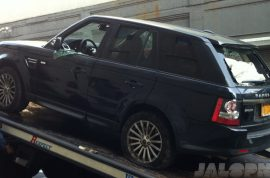 Here is a picture of Alexian Lien's Range Rover after the biker attacks.