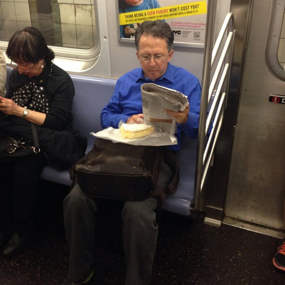NYC subway commuter revels in huge block of brie cheese