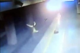 Video: Indian suicidal woman jumps in front of speeding train, survives unharmed.