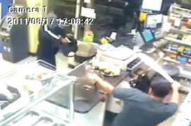 Video: Machete wielding store clerk chases off robber.