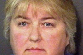 Social worker, Wanda Sue Larson arrested after child is found handcuffed to porch with chicken around his neck.