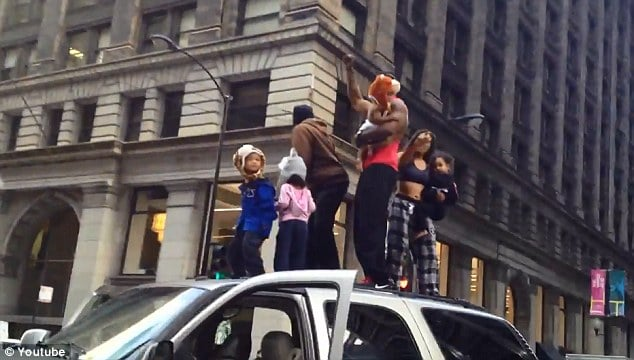 Chicago rooftop SUV dance