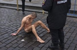 NSFW Video: Russian artist nails scrotum to ground to protest police brutality.