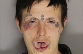This is the tatooed face of man who killed his friend and left his body for children to find.