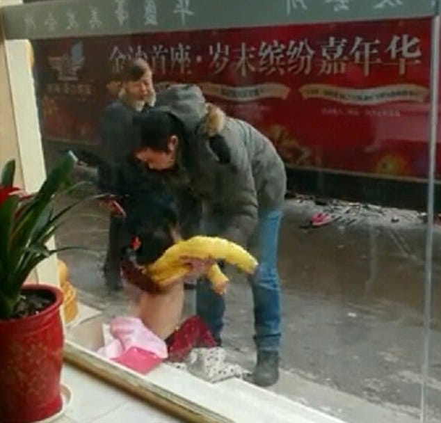 Chinese father stripping and dragging daughter