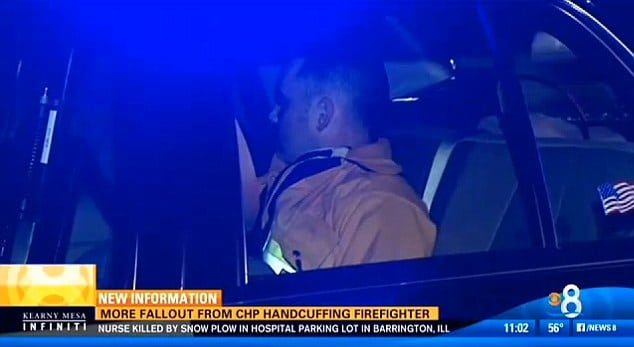 firefighter arrested by cop