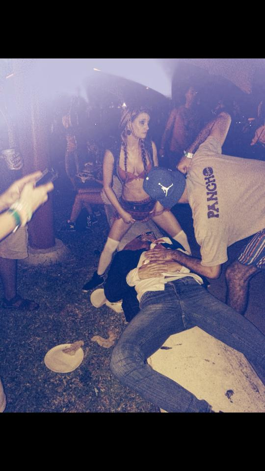 Girl peeing on a man's face at Ultra music festival