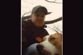 Man shoots neighbor's dog and poses with its body for Facebook selfie.