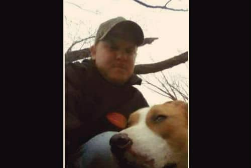 Man shoots neighbor's dog and poses with its body