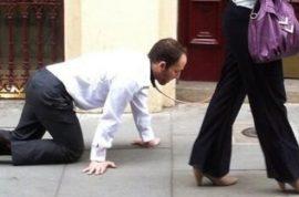 Video: London woman walking man on a leash. Did he lose a bet?