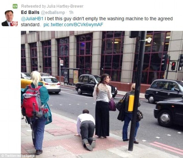 London woman walking man on a leash