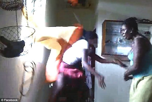 Caribbean mother beating daughter