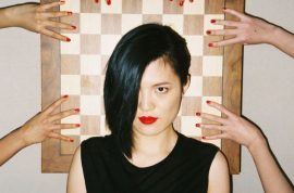 Yifan Hou, World Chess champion strikes glamorous Oyster magazine pose.