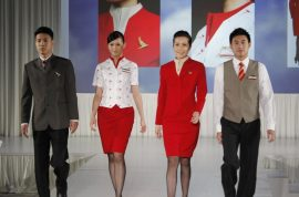 Cathay Pacific air stewardesses complain uniform is too revealing.