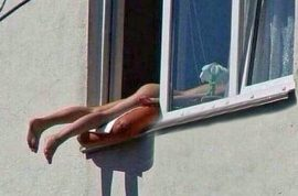 Naked Austrian sunbather causes pile up after hanging out of window