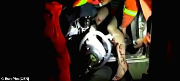 Naked Chinese woman breaks both legs during threesome car crash.