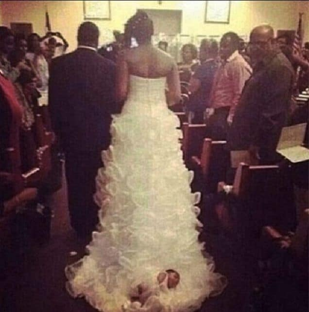 Bride ties newborn baby on her wedding dress gown, drags her down aisle.