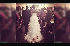 Idiot Bride ties newborn baby on her wedding dress gown, drags her down aisle.