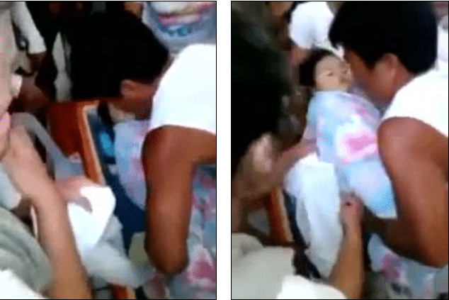 three year old Filipino girl waking up at her own funeral