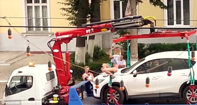 Russian woman performs amazing pole dance before cops tow her car