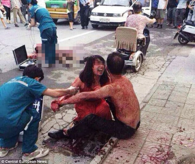 Chinese husband stabs his wife's male friend on street after believing the pair to have affair