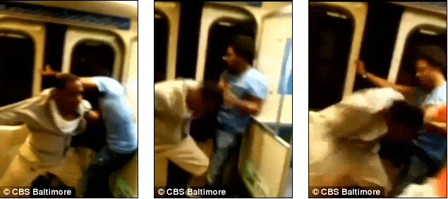 Two Baltimore teens trying to throw man off moving train