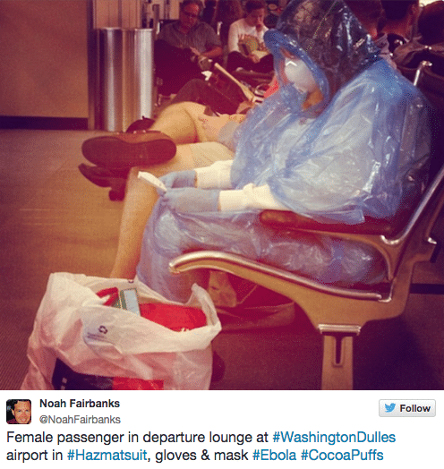 Female Passenger wears hazmut suit at Washington Dulles airport