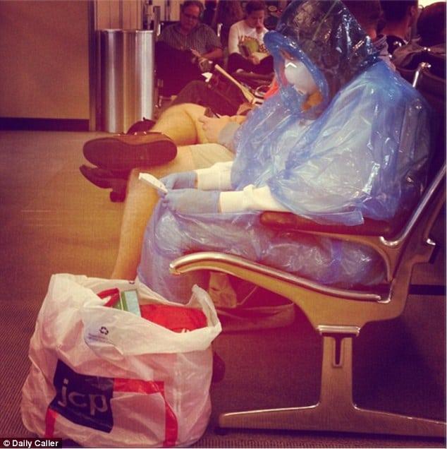 Female Passenger wears hazmut suit at Washington Dulles airport