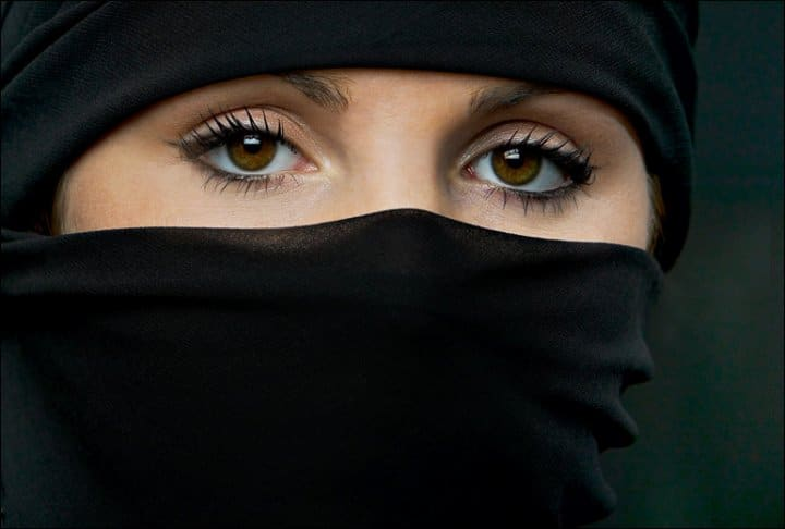 Muslim Woman wearing niqab veil out of Paris Opera
