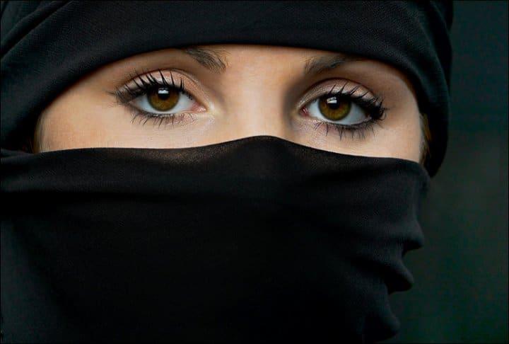 Muslim Woman wearing niqab veil out of Paris Opera