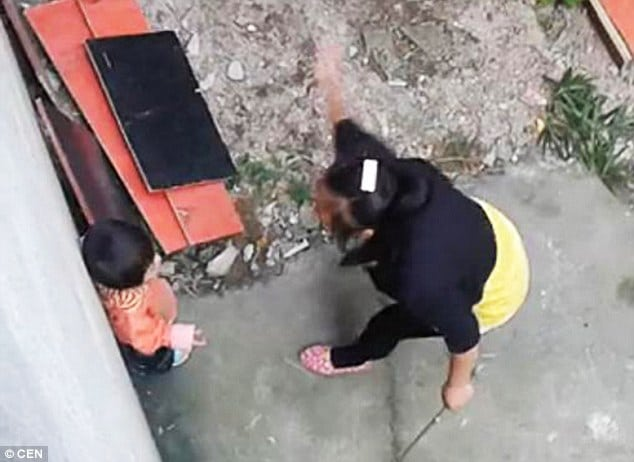 Chinese stepmother whips and kicks toddler for wetting herself