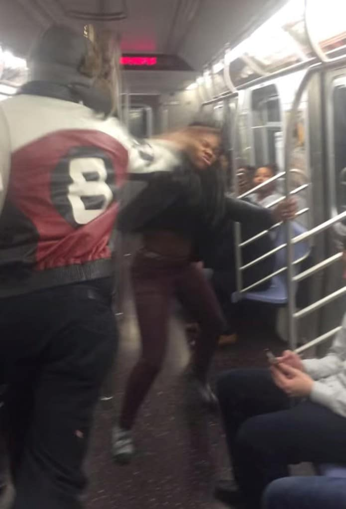 Man smacks the soul out of girl on the NY Subway