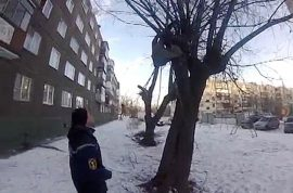 Russian student depressed over love life survives suicide bid dangling by his foot of tree branch after jumping out of balcony