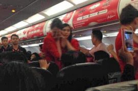 Thai AirAsia flight attendant scalded with hot water and noodles cause passenger wanted to sit next to boyfriend