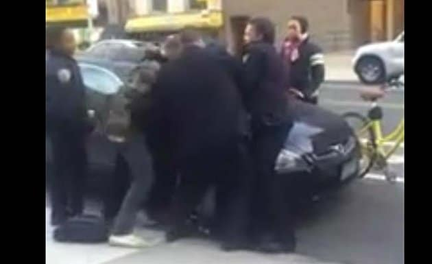 Twelve year old black boy beat up by white NYPD cop