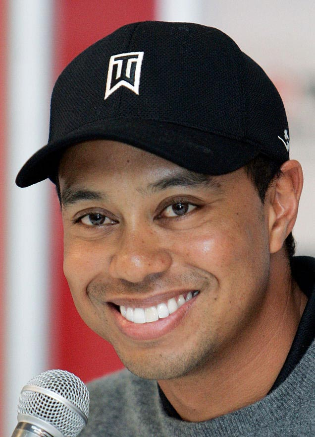 Tiger Woods without his fake front tooth