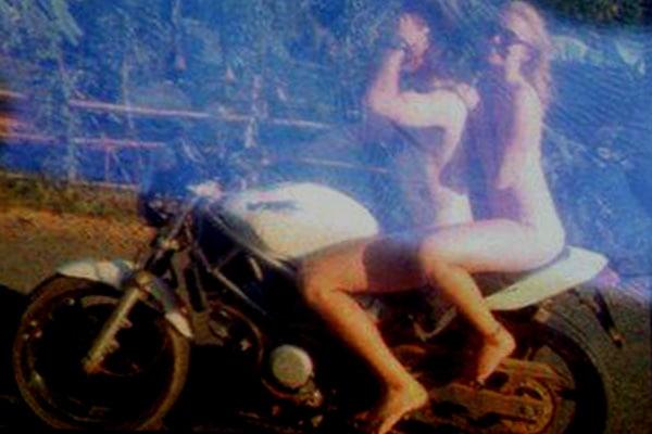 Trio riding motorbike naked through Cambodia