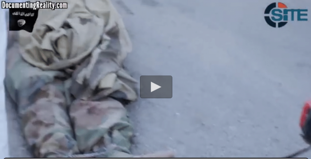 ISIS mob drag three Syrian soldier corpses