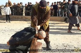 Video: ISIS behead man for witchcraft. Large crowd gather.